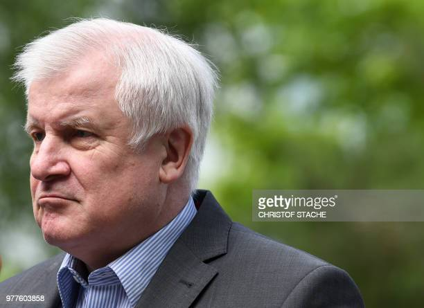 German Interior Minister and leader of the Christian Social Union Party Horst Seehofer arrives at his party headquarters in Munich on June 18 2018 to...