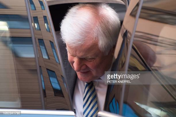 German Interior Minister and leader of the conservative Christian Social Union party Horst Seehofer gets off his car as he arrives for exploratory...