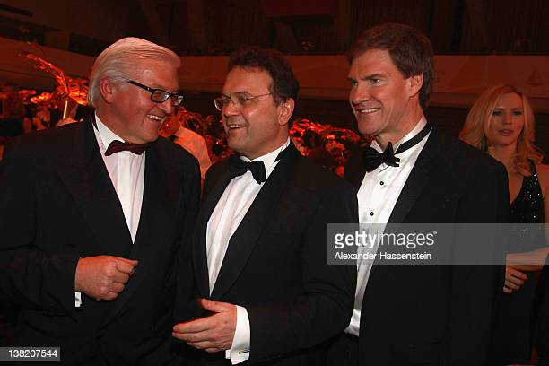 German Interior Minister HansPeter Friedrich talks to FrankWalter Steinmeier and Carsten Maschmeyer during the 2012 Sports Gala 'Ball des Sports' at...