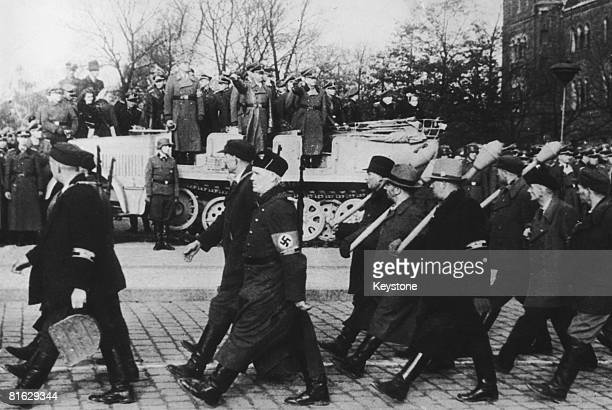 German Interior Minister Heinrich Himmler takes the salute at the march past of newlyformed German home guard militia or Volkssturm units Berlin...