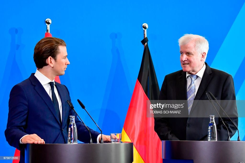 German Interior Minister Horst Seehofer (R) and Austrian Chancellor Sebastian Kurz attend a press conference at the Interior Ministry in Berlin, on June 13, 2018.