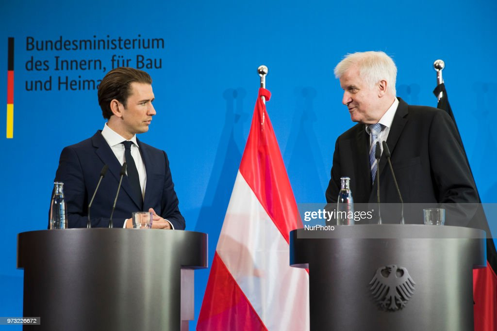 German Interior Minister Horst Seehofer (R) and Austrian Chancellor Sebastian Kurz (L) are pictured during a press conference at the Interior Ministry in Berlin, Germany on June 13, 2018.