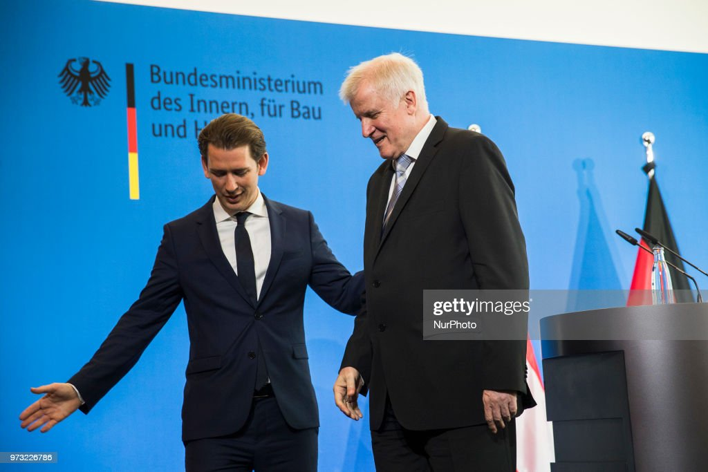 German Interior Minister Horst Seehofer (R) and Austrian Chancellor Sebastian Kurz (L) leave a press conference at the Interior Ministry in Berlin, Germany on June 13, 2018.