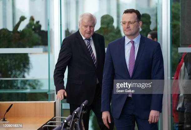 German Interior Minister Horst Seehofer and Health Minister Jens Spahn arrive to speak to the media about the spread of the coronavirus in Germany on...