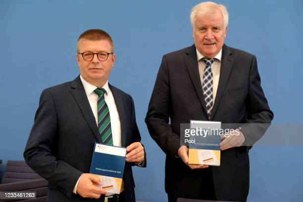 German Interior Minister Horst Seehofer and President of the Federal Office for the Protection of the Constitution Thomas Haldenwang attend the...