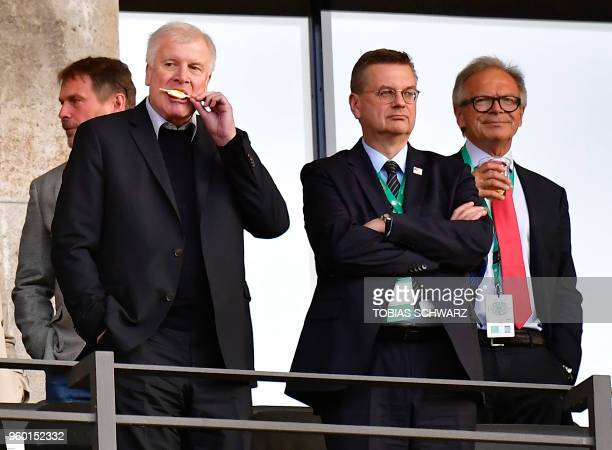 German Interior Minister Horst Seehofer and president of the German Football Association Reinhard Grindel attend the German Cup DFB Pokal final...