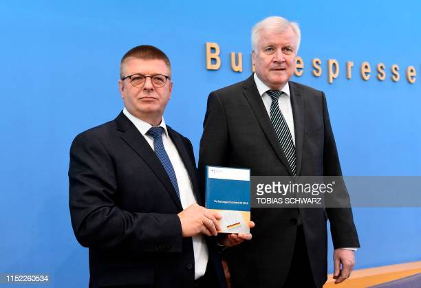 German Interior Minister Horst Seehofer and the President of Germany's domestic intelligence service Thomas Haldenwang pose during a press conference...