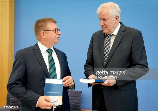 German Interior Minister Horst Seehofer and Thomas Haldenwang, head of the German Federal Office for the Protection of the Constitution, hold the...