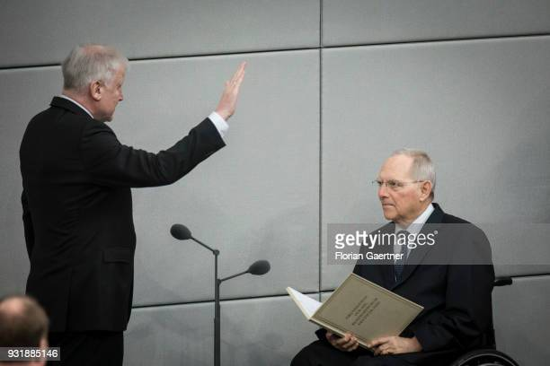 German Interior Minister Horst Seehofer and Wolfgang Schaeuble President of the Bundestag are pictured during the swearingin ceremony of the new...
