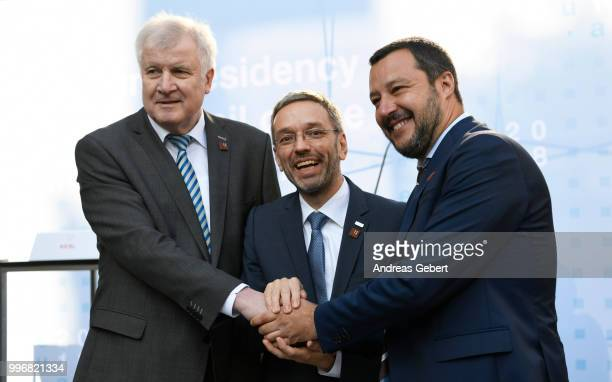 German Interior Minister Horst Seehofer Austrian Interior Minister Herbert Kickl and Italian Interior Minister Matteo Salvini shake hands after at a...