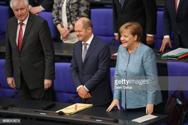 German Interior Minister Horst Seehofer Finance Minister and Vice Chancellor Olaf Scholz and Chancellor Angela Merkel attend debates at the Bundestag...
