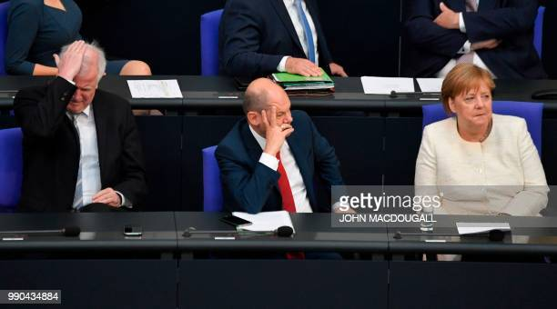 German Interior Minister Horst Seehofer, German Finance Minister and Vice-Chancellor Olaf Scholz and German Chancellor Angela Merkel attend a session...