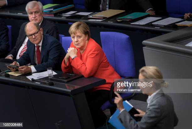 German Interior Minister Horst Seehofer German Finance Minister Olaf Scholz and German Chancellor Angela Merkel are pictured during the speech of...
