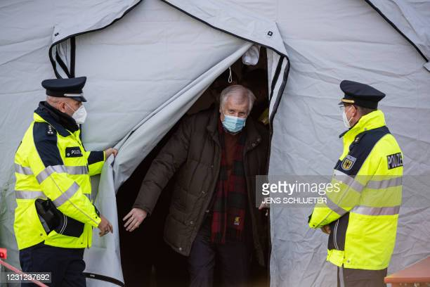 German Interior Minister Horst Seehofer leaves a tent during his visit of Germany's Federal Police that carries out controls at the German-Czech...