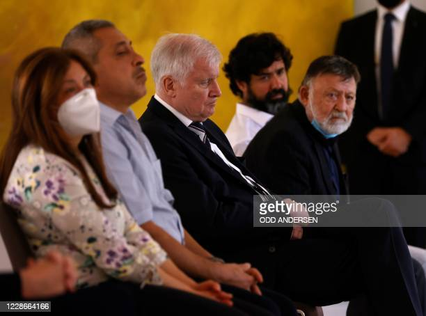 German Interior Minister Horst Seehofer listens to a speech of German President after he met with relatives of Hanau attack victims on September 23,...