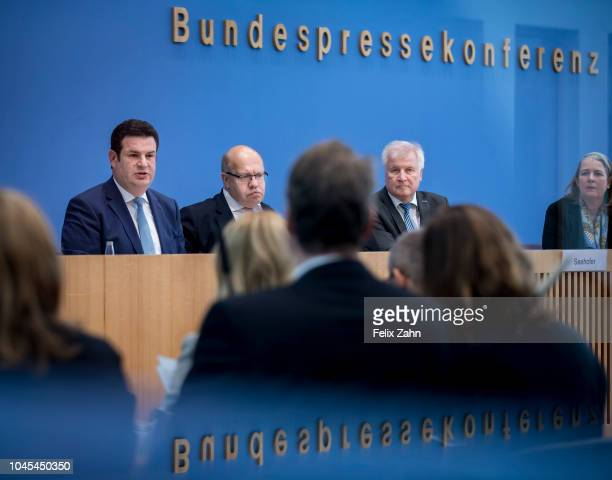 German Interior Minister Horst Seehofer speaks during a press conference with German Labour Minister Hubertus Heil German Economy Minister Peter...