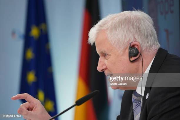 German Interior Minister Horst Seehofer speaks to the media via video conference following a virtual informal meeting of European Union interior...