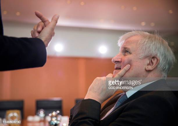German Interior Minister Horst Seehofer speaks with the Federal Government's Commissioner for Culture and the Media Monika Gruetters as they arrive...