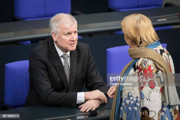 German Interior Minister Horst Seehofer talks with Claudia Roth VicePresident of the Bundestag after the swearingin ceremony of the new federal...