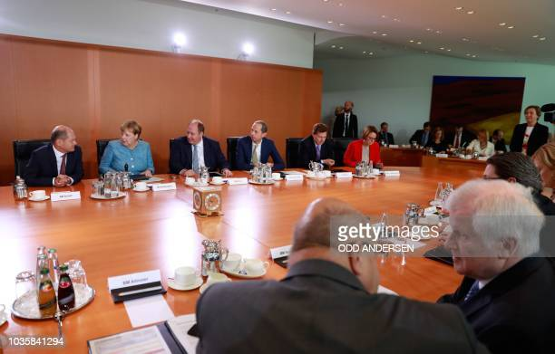 German Interior Minister Horst Seehofer talks with German Economy Minister Peter Altmaier as German Chancellor Angela Merkel prepares to lead the...