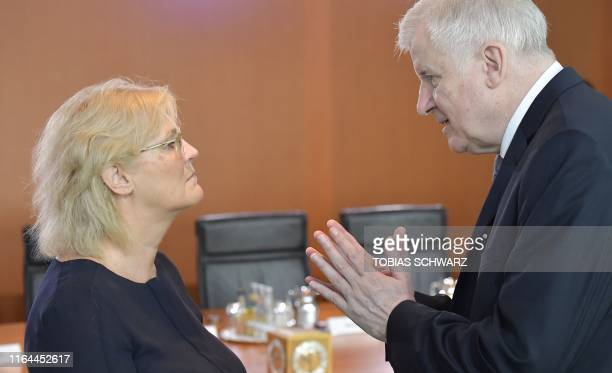 German Interior Minister Horst Seehofer talks with German Justice Minister Christine Lambrecht prior to the weekly cabinet meeting in Berlin on...