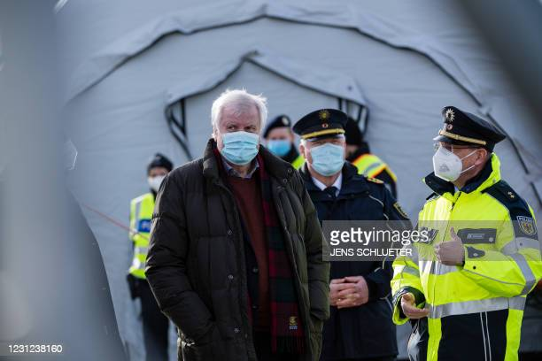 German Interior Minister Horst Seehofer wears a face mask as he leaves a tent during his visit of Germany's Federal Police that carries out controls...