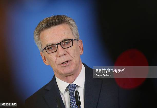 German Interior Minister Thoma de Maiziere speaks to the media to announce that authorities launched 200 raids against Islamists across Germany today...