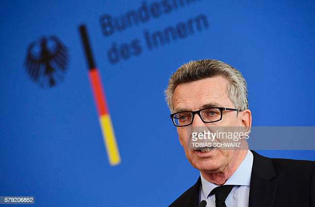German Interior Minister Thomas de Maiziere addresses a press conference in Berlin on July 23 2016 one day after one day after a teenage...