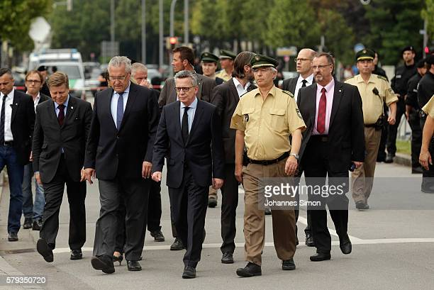 German interior minister Thomas de Maiziere and Bavarion Interior minister Joachim Herrmann attend the crime scene at OEZ shopping center the day...