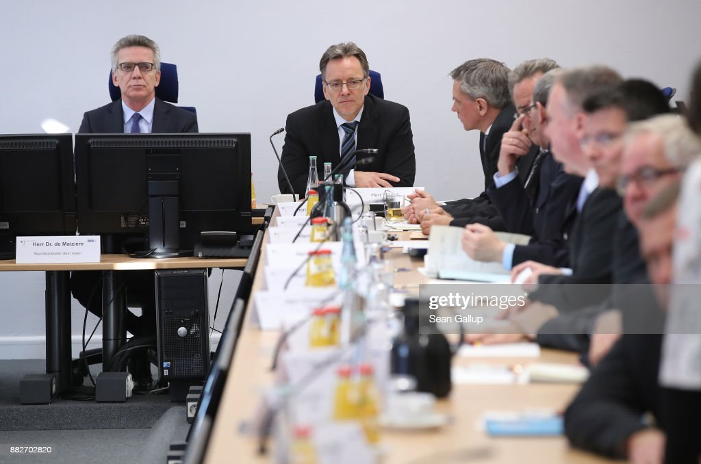 German Interior Minister Thomas de Maiziere (L) and Federal Criminal Office (Bundeskriminalamt) President Holger Muench (C) speak to colleagues about the current state of Islamic terrorism in Germany at the GTAZ anti-terror center on November 30, 2017 in Berlin, Germany. The GTAZ, in German called the 'Gemeinsame Terrorismusabwehrzentrum,' or Joint Anti-Terrorism Center, combines the efforts of various German law enforcement agencies to thwart terror attacks and organizations in Germany and abroad.