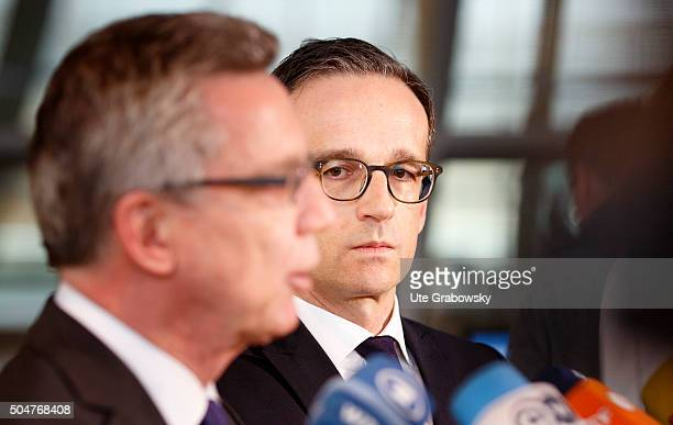 German Interior Minister Thomas de Maiziere and German Justice Minister Heiko Maason giving a statement to the press on January 12 2016 in Berlin...