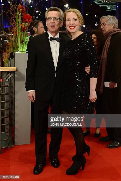 German Interior Minister Thomas de Maiziere and his daughter Nora arrive for the premiere screening of the film 'Nadie quiere la noche' presented in...