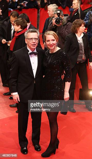German Interior Minister Thomas de Maiziere and his daughter Nora arrive for the 'Nobody Wants the Night' premiere and the opening gala of the 65th...