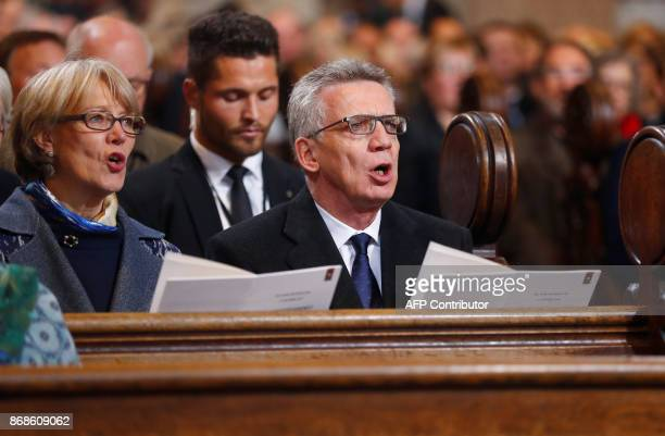 German Interior Minister Thomas de Maiziere and his wife Martina de Maiziere attend a celebratory mass in the Schlosskirche in Wittenberg, eastern...
