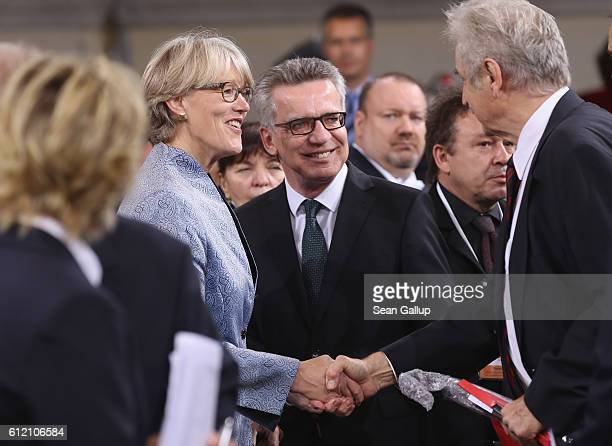German Interior Minister Thomas de Maiziere and his wife Martina arrive for a commemoratory service at the Frauenkirche church during celebrations to...