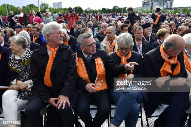 German Interior Minister Thomas de Maiziere and his wife Martina attend in Berlin on May 24 2017 the opening mass of the Kirchentag festival...