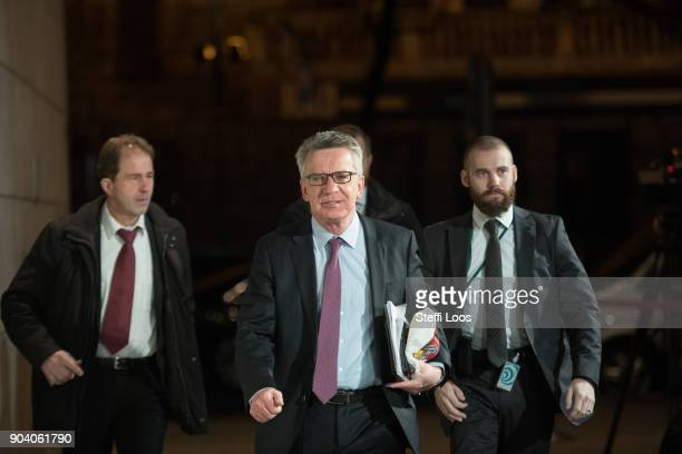 German Interior Minister Thomas de Maiziere arrives after a break at the headquarters of the German Social Democrats where preliminary coalition...