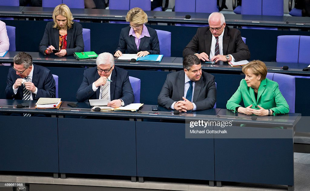 German Interior Minister Thomas de Maiziere, German Family Minister Manuela Schwesig, German Foreign Minister Frank-Walter Steinmeier, German Defense Minister Ursula von der Leyen, German Economy Minister and Vice Chancellor Sigmar Gabriel and German Chancellor Angela Merkel attend the budget debate in German Bundestag on November 25, 2014 in Berlin, Germany. German Finance Minister Wolfgang Schaeuble wants EU to have budget veto powers over national budgets that breach Eurozone criteria.