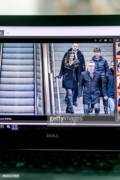 German Interior Minister Thomas de Maiziere is seen on the screen of one of thee monitoring systems during his visit to a project for automatic...