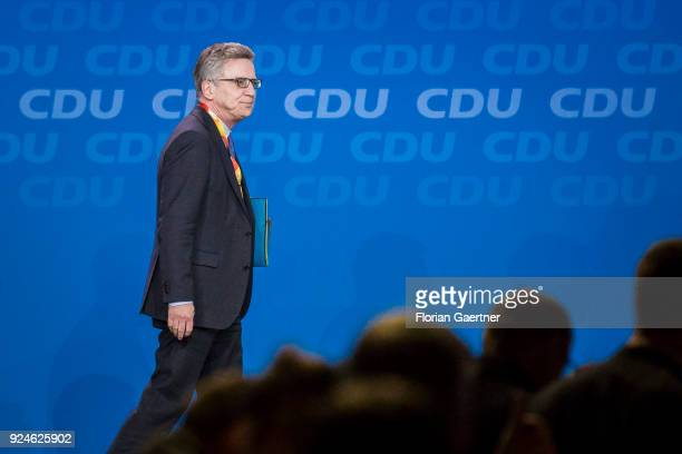 German Interior Minister Thomas de Maiziere leaves the stage at the 30th German Christian Democrats party congress on February 26 2018 in Berlin...