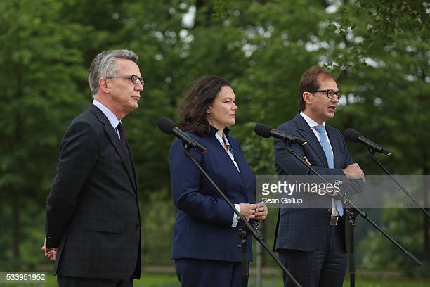 German Interior Minister Thomas de Maiziere Minister of Work and Social Issues Andrea Nahles and Transport and Digital Technologies Minister...
