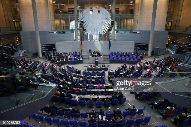 German Interior Minister Thomas de Maiziere speaks at the Bundestag during debates over a proposal concerning the rights of refugees who have been...