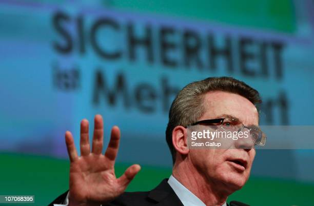 German Interior Minister Thomas de Maiziere speaks under a sign that reads 'Security Is Added Value' at the annual convention of the Labour Union of...