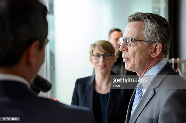 German Interior Minister Thomas de Maiziere tours the Berlin office of Facebook on August 29 2016 in Berlin Germany The German government has put...