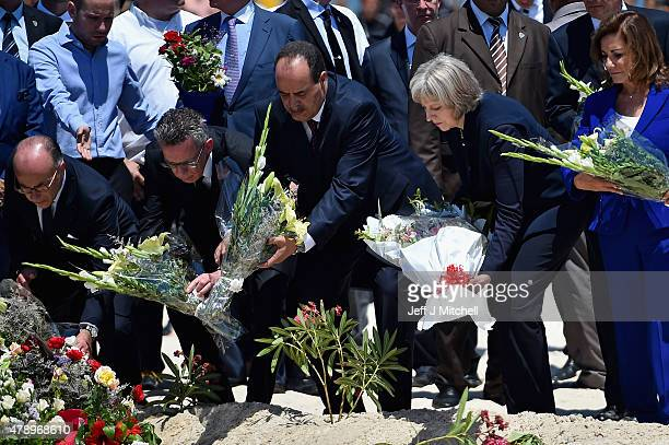 German Interior Minister Thomas de Maiziere Tunisia's Interior Minister Mohamed Gharsalli British Home Secretary Theresa May lays flowers at the...
