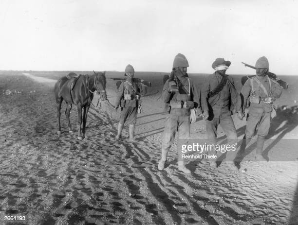 A German intermediary is brought through the lines at Modder River Camp in to negotiate a surrender during the second Boer War Original Publication...