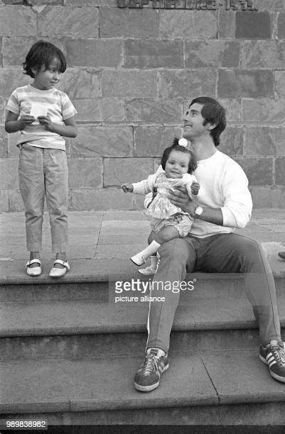German international football player Gerd Mueller with two Mexcian children in Guanajuato during a team trip during the 1970 FIFA World Cup in Mexico