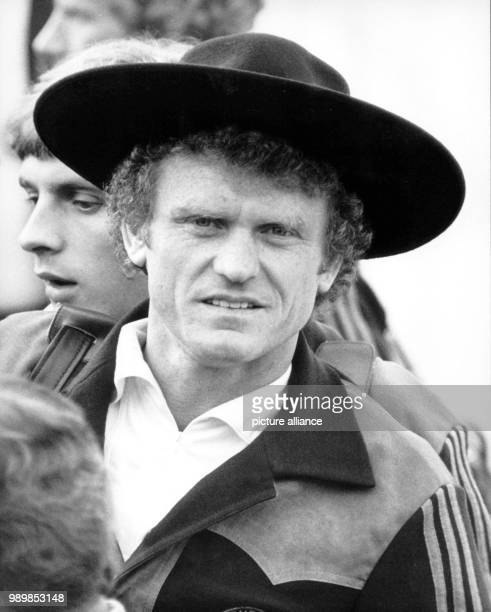 German international goalkeeper Sepp Maier is wearing a poncho and a gaucho hat. These presents were given to the German football national team upon...