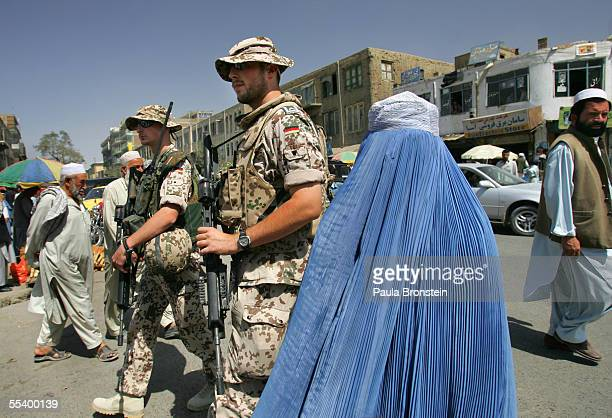 German ISAF Einsatzkompanie patrol in the busy marketplace September 14, 2005 in Kabul, Afghanistan. Security has been stepped up ahead of the...