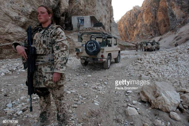 German ISAF soldier stands guard in a canyon while on patrol in the Marmal mountains March 8 2008 in Mazare Sharif Afghanistan German Chancellor...